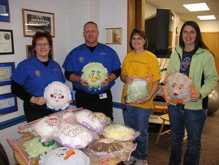 Members holding some of the donated pillows
